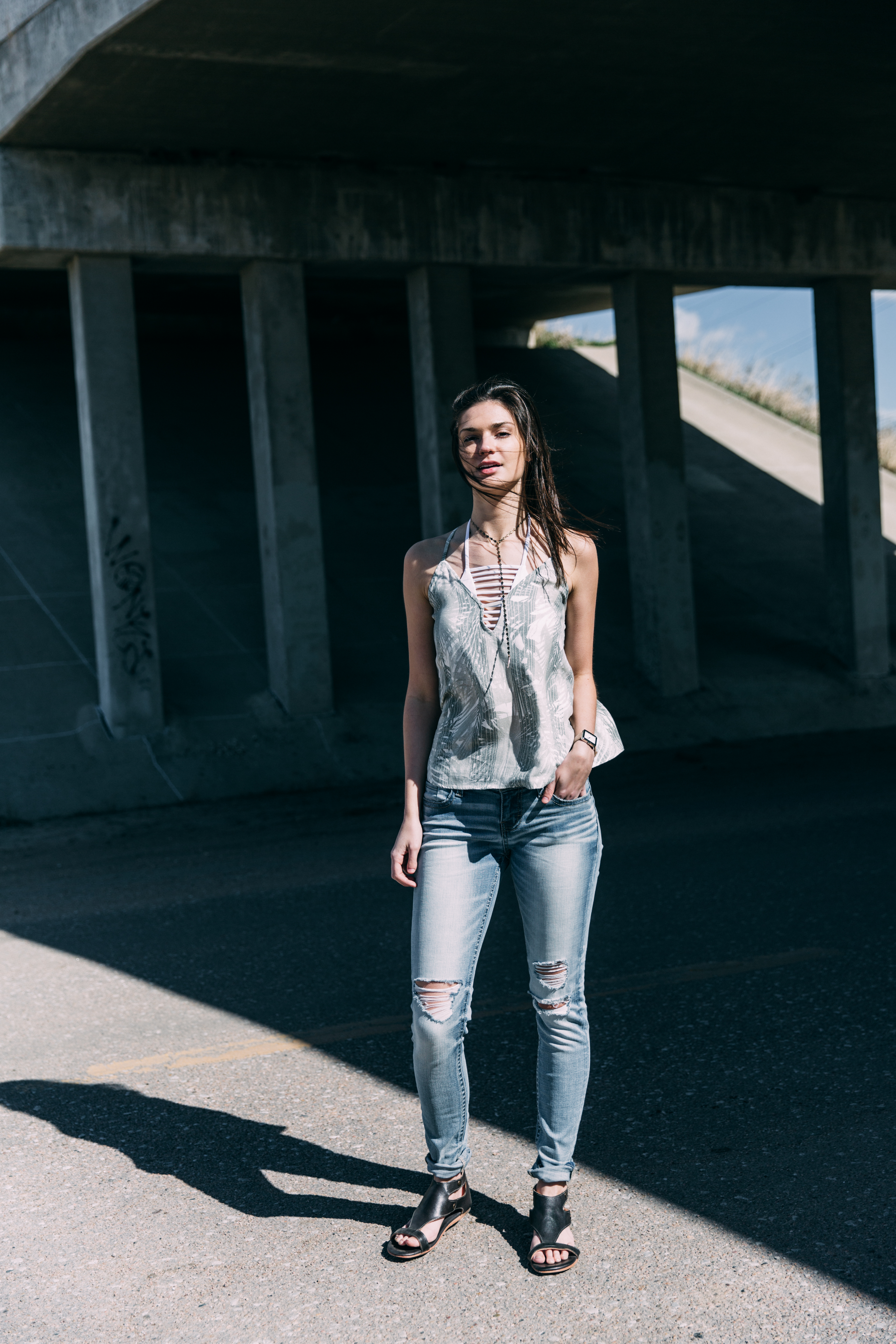 Buckle Black fit No. 53 jeans on a girl in a white bodysuit.