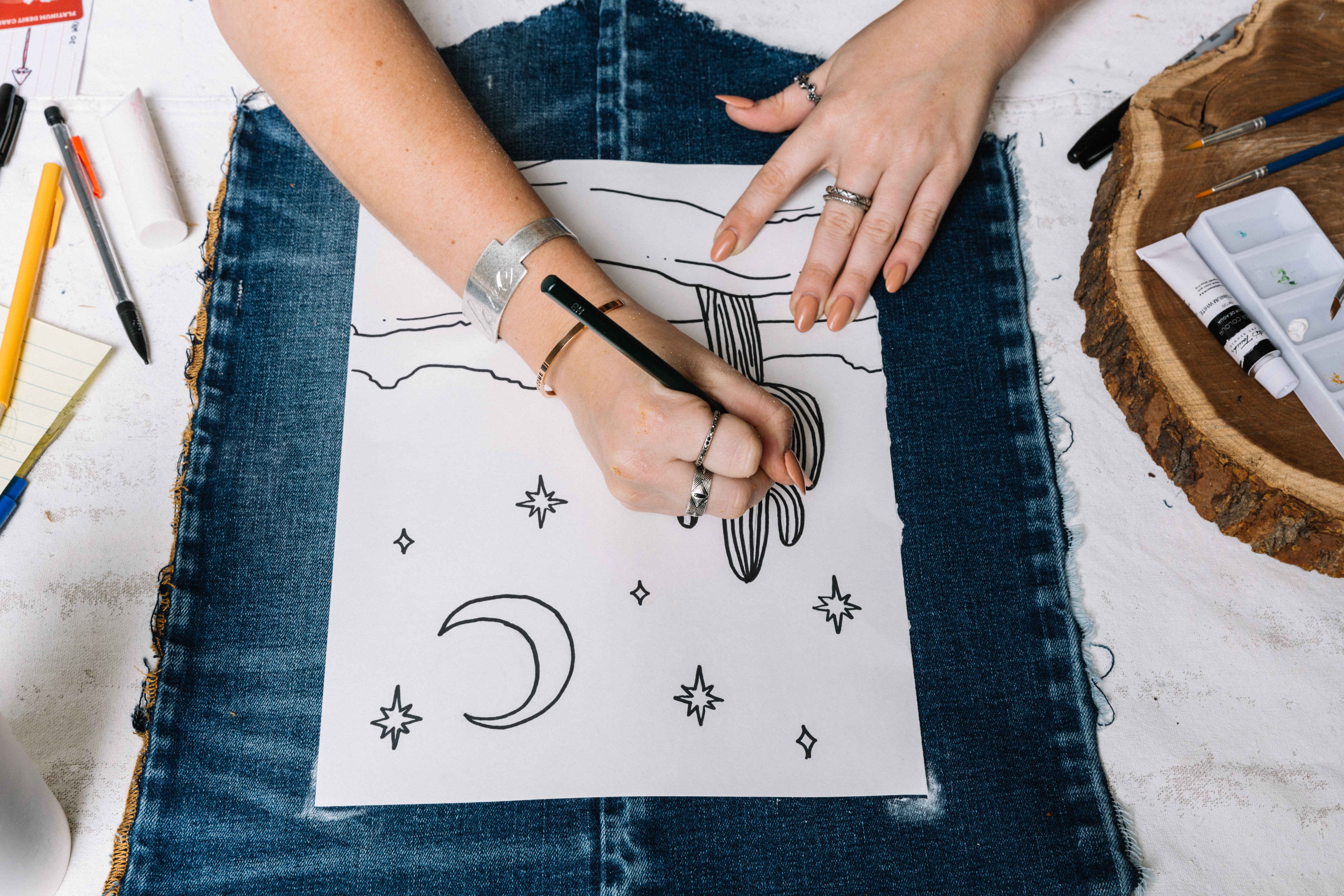 Painting the denim tapestry.