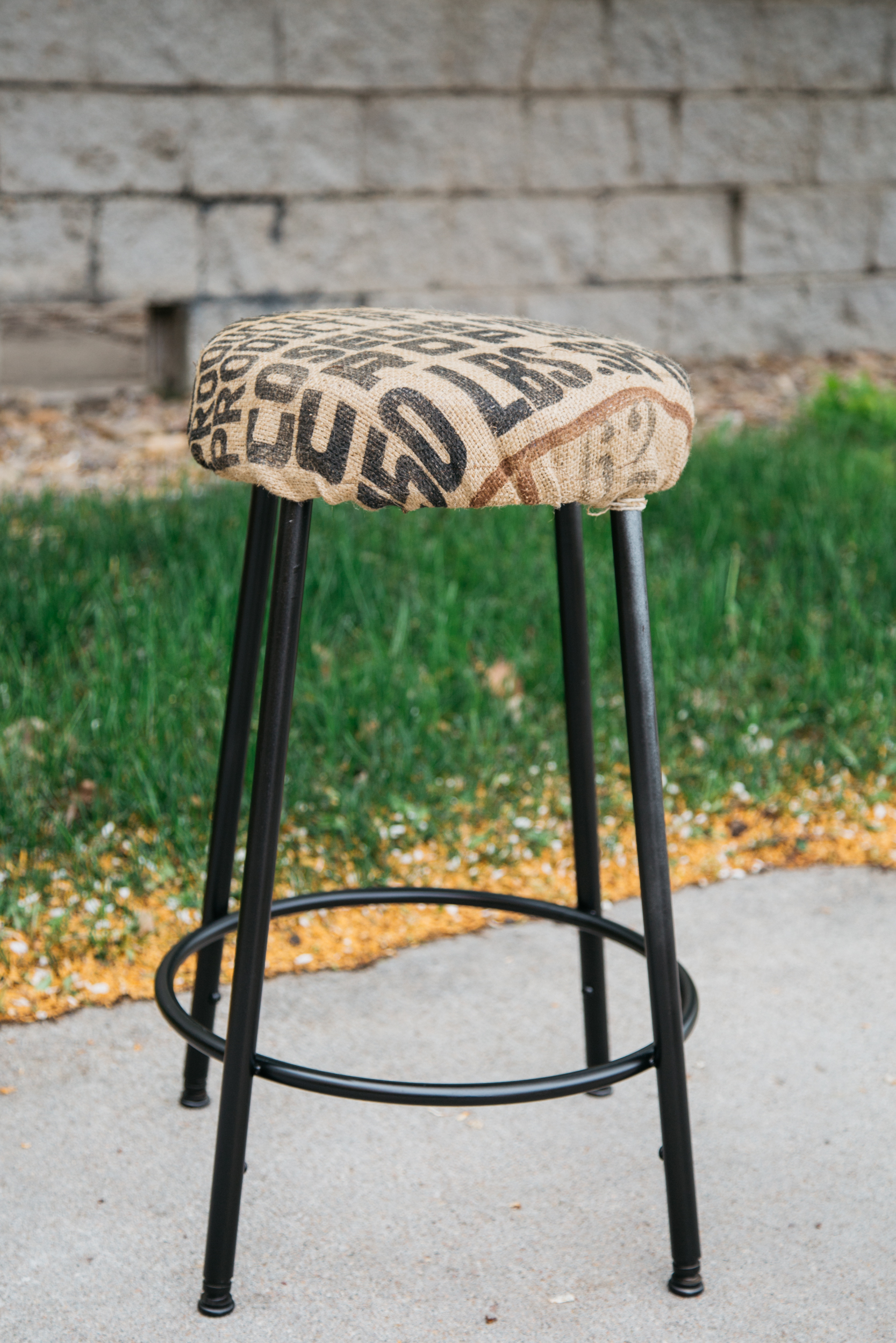 A burlap sack turned into a bar stool cover.