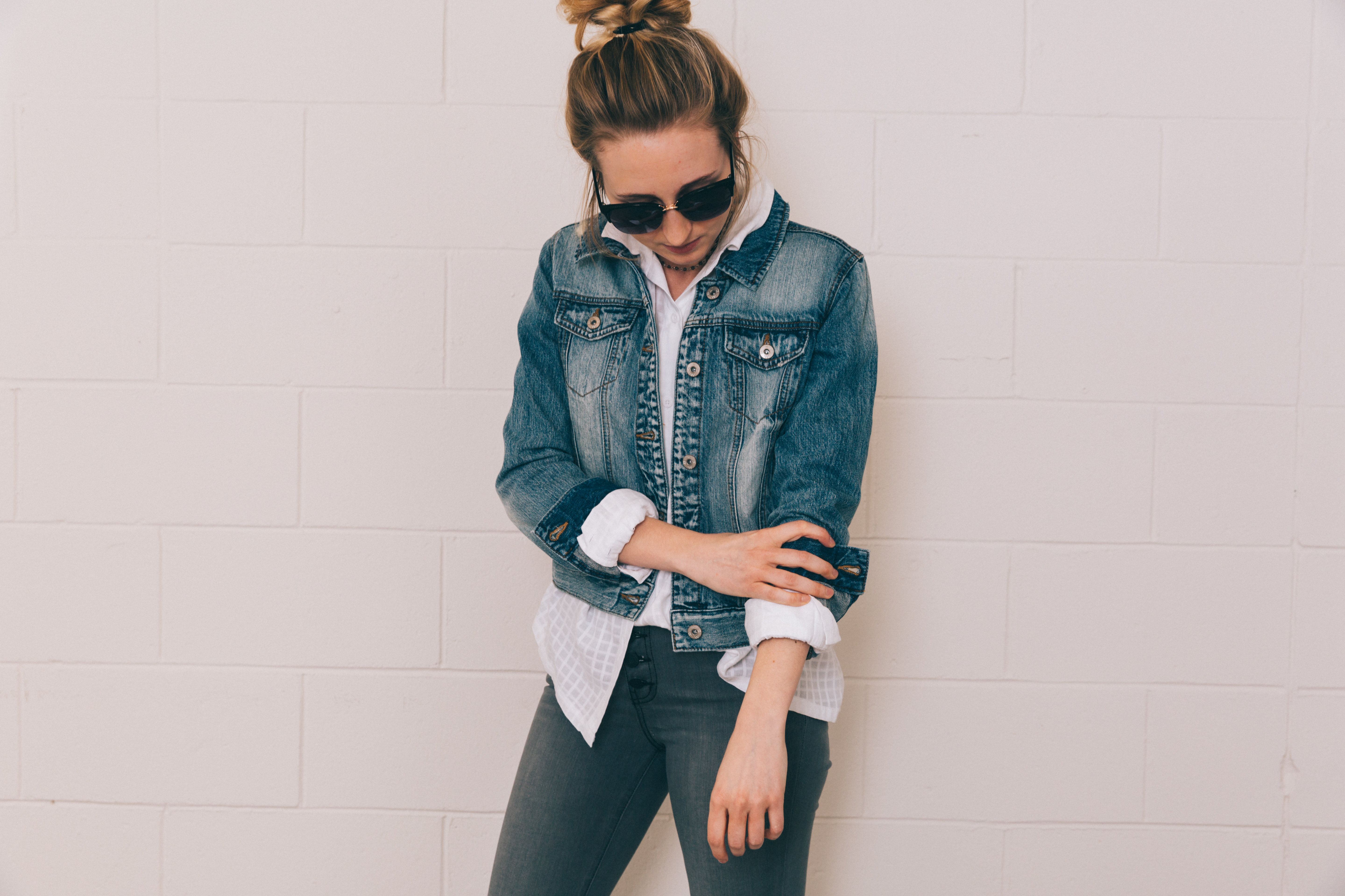 Girl in a white button-down and denim jacket.