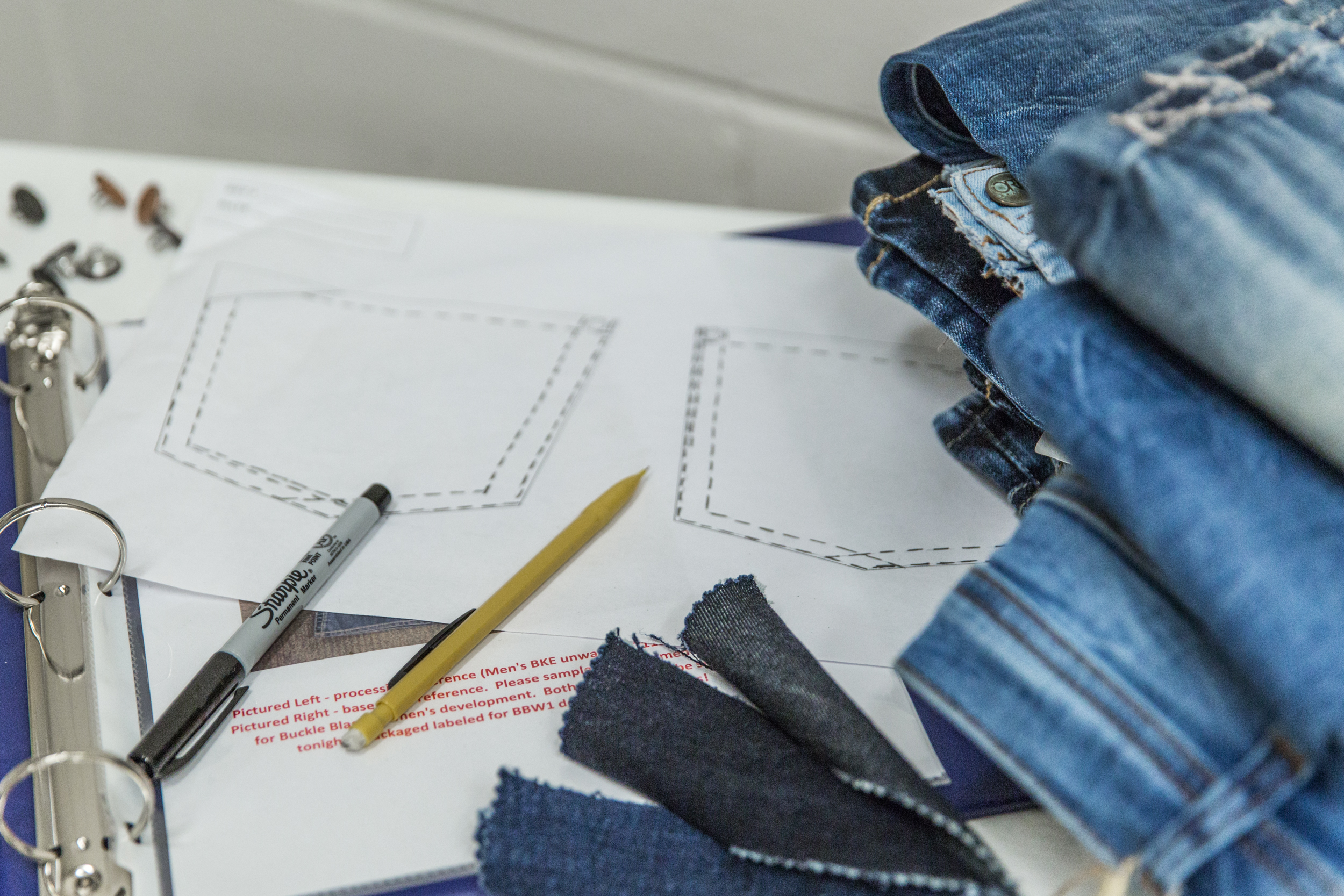Photo of Buckle Black's first pocket designs and jeans sold.