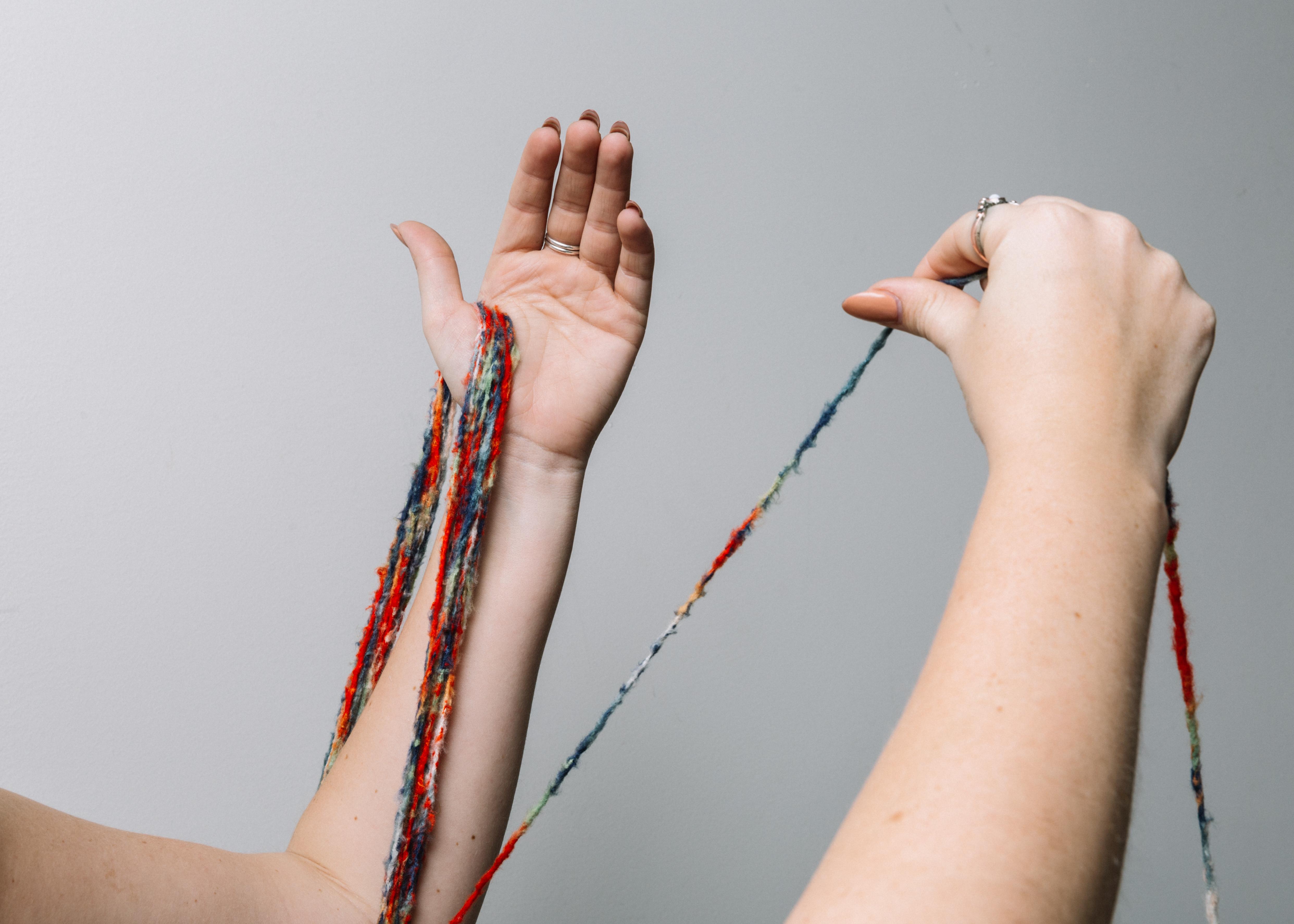Tying string onto a branch.