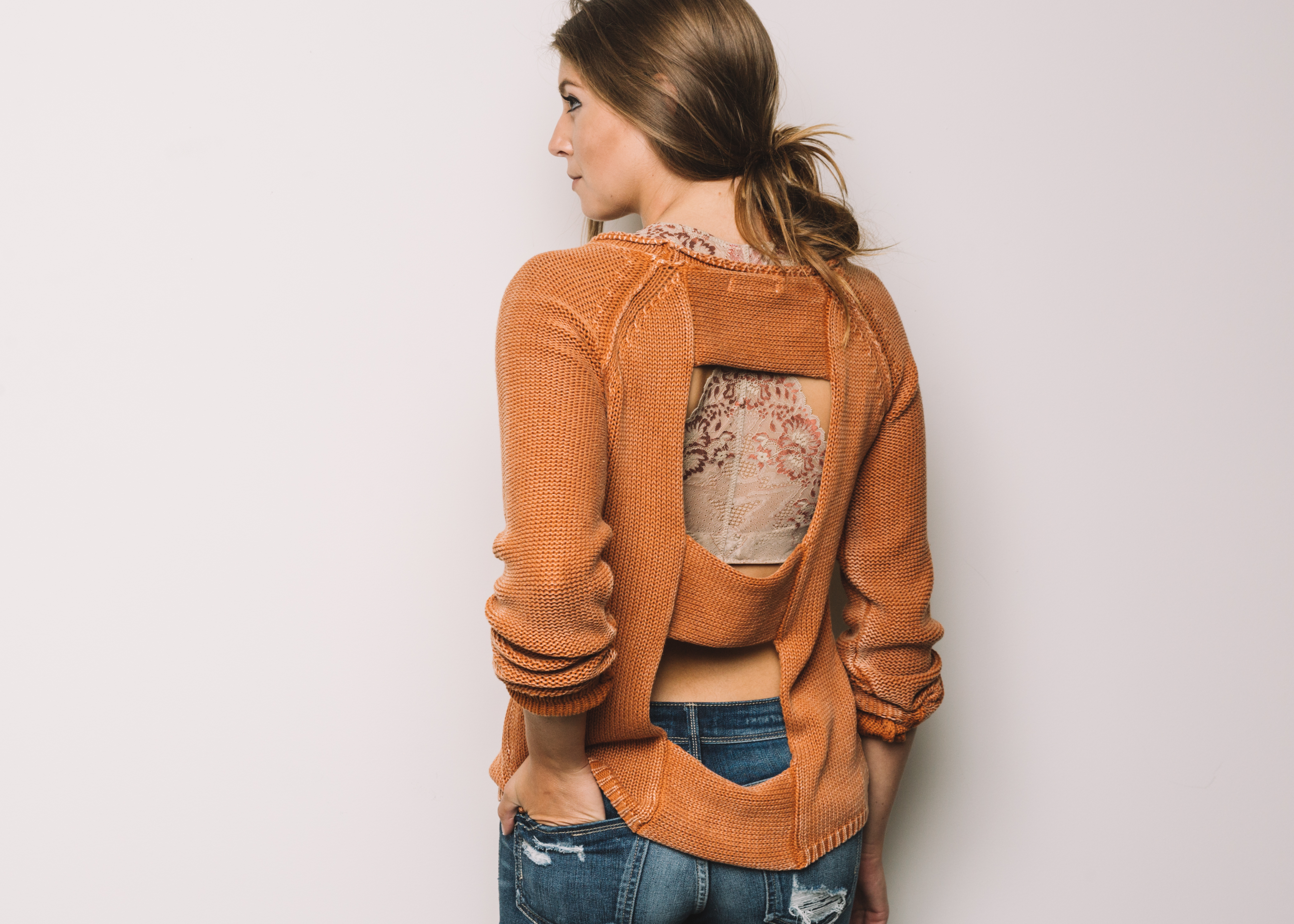 #BareYourBralette this October to raise awareness for Breast Cancer Prevention and Early Detection | Outfit: washed orange Gilded Intent knit sweater, paired with a Daytrip lace racer back bralette, and Gilded Intent distressed ankle skinny denim.