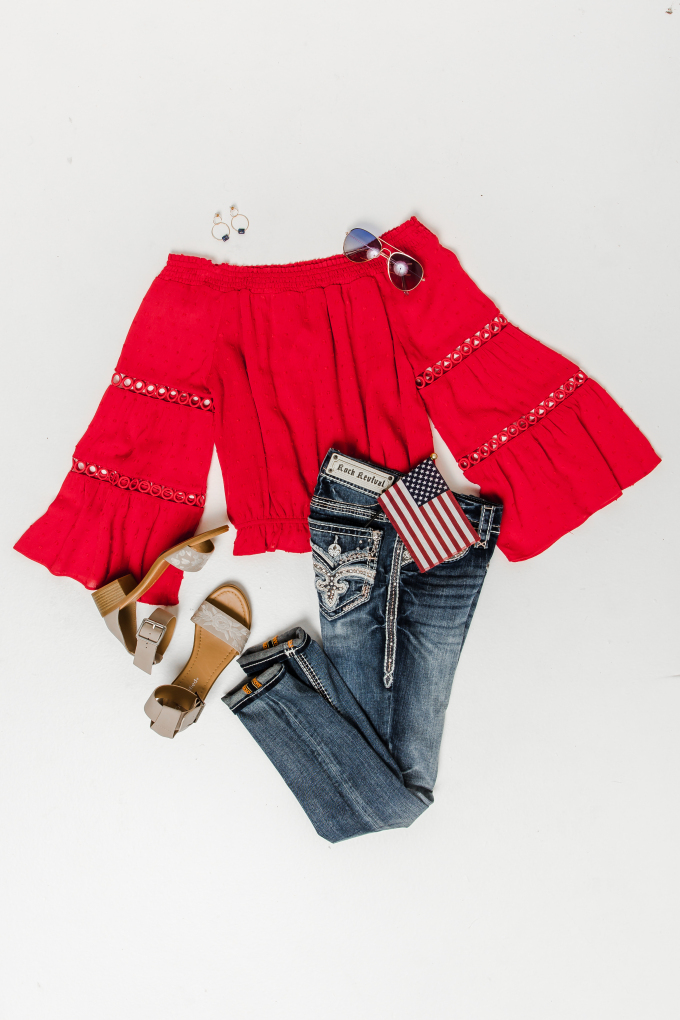 Rock Revival jeans paired with a red, off-the-shoulder, statement sleeve top, and embroidered nude heels.