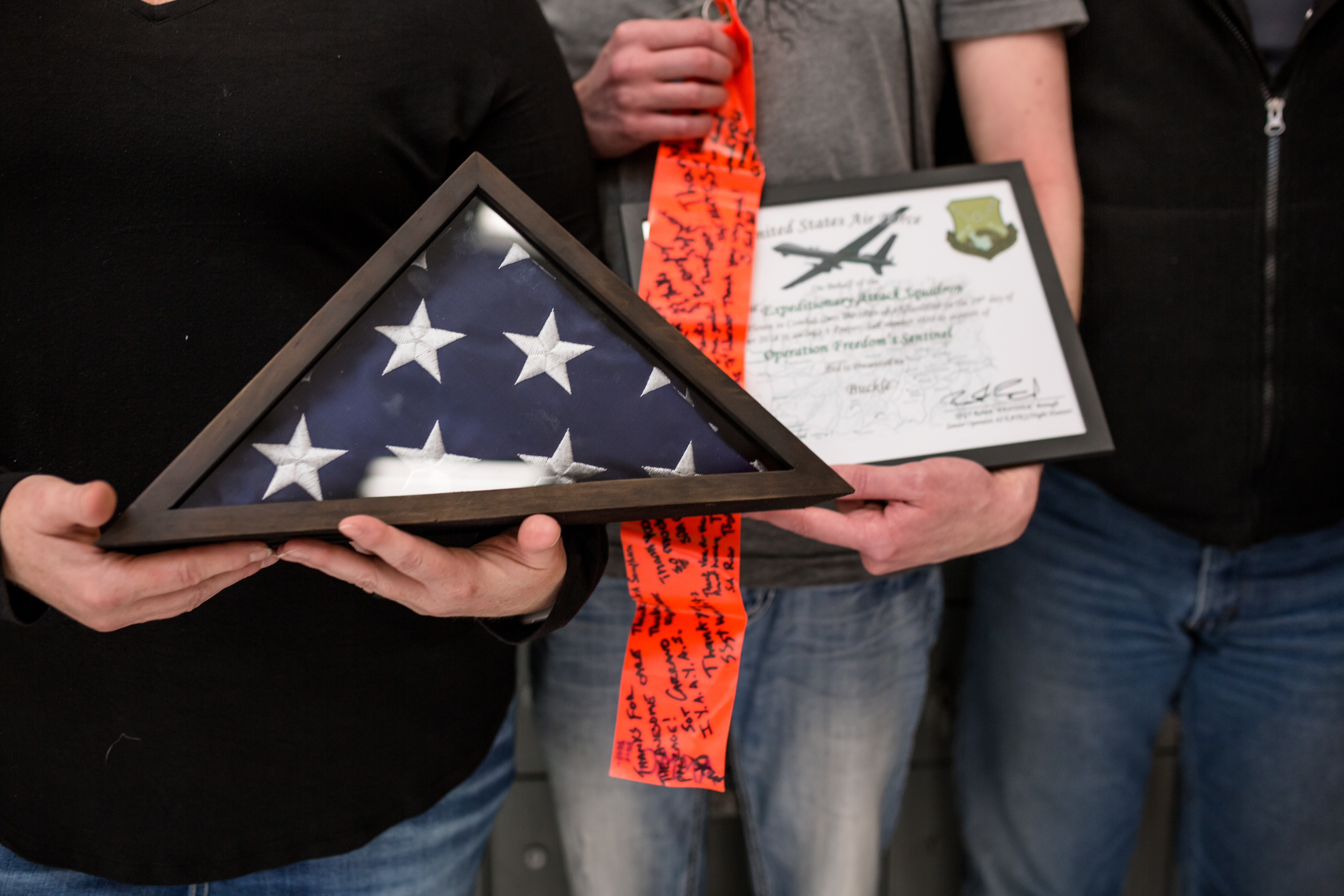 Buckle honored by United States Air Force with certificates and flag flown in Afghanistan during a combat mission in support of Operation Freedom's Sentinel